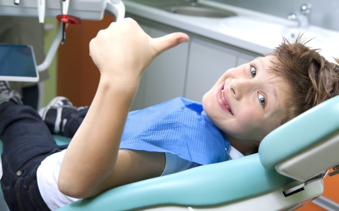 young boy at dentist to get sealant to prevent tooth decay
