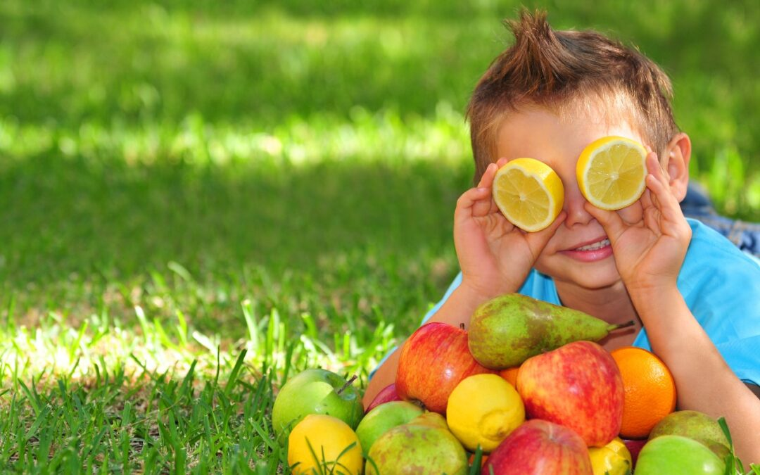 kid with healthy easter food in front of face